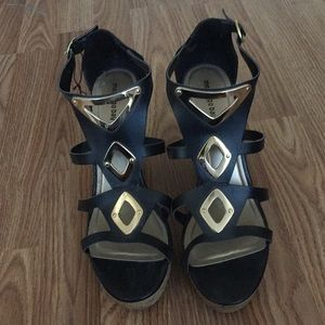 Size 11 black and gold wedge heels -like new